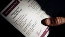 A person holds an Elections Canada voter information card after receiving it in the mail on Tuesday, Aug 31, 2021. (THE CANADIAN PRESS / Sean Kilpatrick)