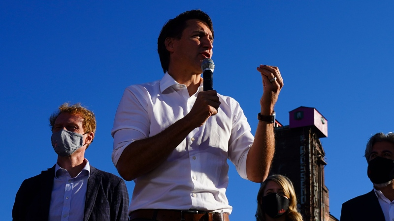 Liberal leader Justin Trudeau is joined by fellow candidates, left to right, Marc Miller, Melanie Joly, and Pablo Rodriquez as he makes a campaign stop in Montreal, Quebec, on Sunday, Sept. 19, 2021. THE CANADIAN PRESS/Sean Kilpatrick