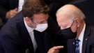U.S. President Joe Biden, right, speaks with French President Emmanuel Macron during a plenary session during a NATO summit at NATO headquarters in Brussels, Monday, June 14, 2021. (Brendan Smialowski, Pool via AP)