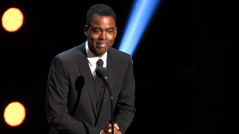In this March 30, 2019 file photo, Chris Rock presents the award for outstanding comedy series at the 50th annual NAACP Image Awards at the Dolby Theatre in Los Angeles. (Photo by Chris Pizzello/Invision/AP, File)
