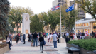 A group held a silent vigil at Saskatoon City Square to protest the rights and freedoms violations over the course of the COVID-19 pandemic. (Pat Mckay/CTV Saskatoon)
