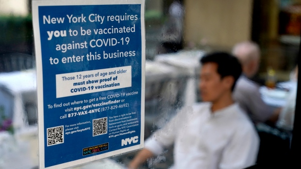 In this Sept. 13, 2021, file photo, a notice explaining that proof of vaccination is required to dine inside is seen at a restaurant in midtown Manhattan in New York. (AP Photo/Seth Wenig, File)