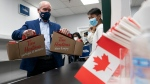 Conservative leader Erin O'Toole brings coffee to a local candidate's campaign office Sunday, September 19, 2021 in Markham, Ont. (THE CANADIAN PRESS / Adrian Wyld)
