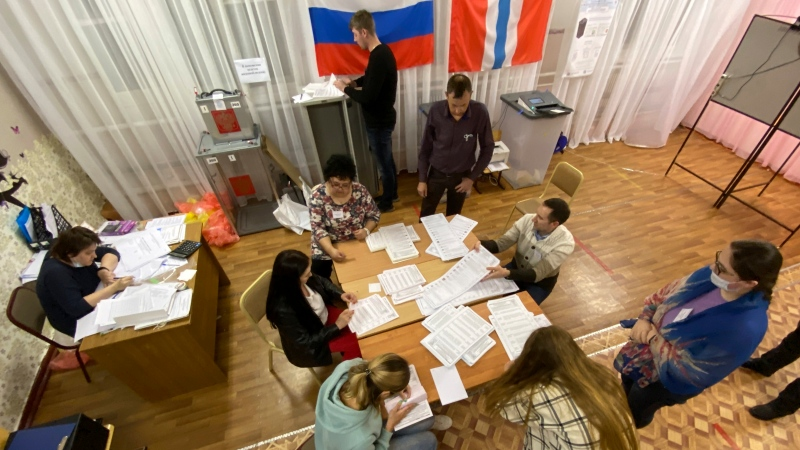Members of an election commission prepare to count ballots after voting at a polling station after the Parliamentary elections in Nikolayevka village outside Omsk, Russia, Sunday, Sept. 19, 2021. From the Baltic Sea to the Pacific Ocean, Russians across eleven time zones voted Sunday on the third and final day of a national election for a new parliament, a ballot in which the pro-Kremlin ruling party is largely expected to retain its majority after months of relentless crackdown on the opposition. (AP Photo/Evgeniy Sofiychuk)