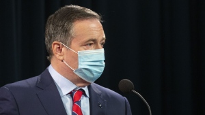 Alberta Premier Jason Kenney takes the podium while wearing a mask at a news conference where the provincial government announced new restrictions because of the surging COVID cases in the province, in Calgary, Alta., Friday, Sept. 3, 2021.THE CANADIAN PRESS/Todd Korol