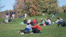 People wear face masks as they gather in Mount Royal Park in Montreal, Monday, October 12, 2020, as the COVID-19 pandemic continues in Canada and around the world. THE CANADIAN PRESS/Graham Hughes