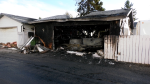 Fire damaged two garages and three vehicles.