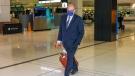 France's Ambassador to Australia Jean-Pierre Thebault arrives at Sydney Airport, Saturday, Sept. 18, 2021. (AP Photo/David Gray)