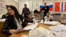Members of an election commission prepare to count ballots after voting at a polling station after the Parliamentary elections in Nikolayevka village outside Omsk, Russia, Sunday, Sept. 19, 2021. (AP Photo/Evgeniy Sofiychuk)