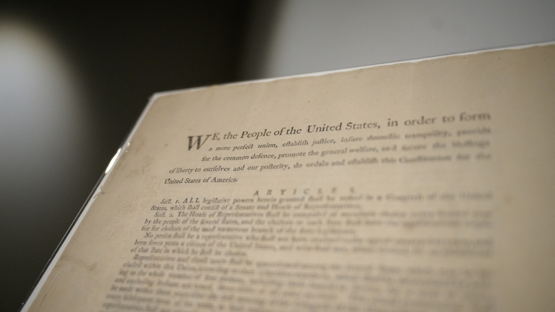 An exceptionally rare first-edition printed copy of the U.S. Constitution is going on sale in New York, with Sotheby's auction house expecting bids up to US$20 million. (ED JONES/AFP/Getty Images)