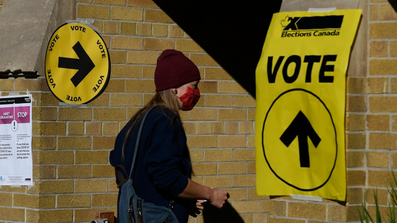 A voter walks into a polling location for the 44th Canadian general federal election in Ottawa on Monday, Sept. 20, 2021. (Justin Tang/THE CANADIAN PRESS)