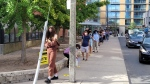 Voters line up outside the Toronto Reference Library to cast their ballot on Election Day. (Chris Herhalt/ CP24.com)