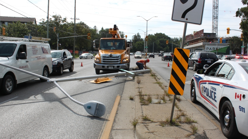 A collision involving a light standard at Springbank Drive and Wonderland Road in London, Ont. on Monday, Sept. 20, 2021. (Gerry Dewan / CTV News)