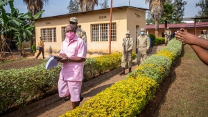 Paul Rusesabagina wears a pink prison uniform as he arrives for a bail hearing at a court in the capital Kigali, Rwanda on Sept. 25, 2020. (Muhizi Olivier / AP)