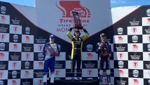 Colton Herta, centre, celebrates his IndyCar victory at Laguna Seca with runner-up Alex Palou, left, and Romain Grosjean in Monterey, Calif., on Sept. 19, 2021. (Jenna Fryer / AP)