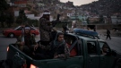 Taliban fighters sit on the back of a pickup truck as they stop on a hillside in Kabul, Afghanistan, Sunday, Sept. 19, 2021. (AP Photo/Felipe Dana)