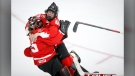 Canada's goalie Ann-Renee Desbiens, left, and Blayre Turnbull celebrates winning the gold medal final against the United States in IIHF Women's World Championship hockey action in Calgary, Aug. 31, 2021.(THE CANADIAN PRESS/Jeff McIntosh)