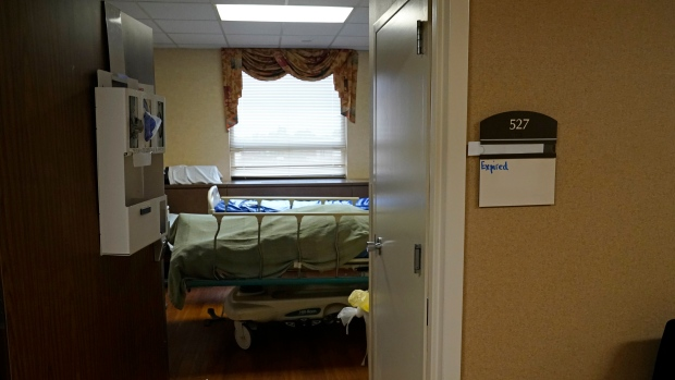 The body of a COVID-19 patient who died sits in a hospital room shortly after death, at the Willis-Knighton Medical Center in Shreveport, La., Wednesday, Aug. 18, 2021. (AP Photo/Gerald Herbert)