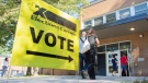 People arrive to cast their ballot on federal election day in Montreal, Monday, September 20, 2021. THE CANADIAN PRESS/Graham Hughes