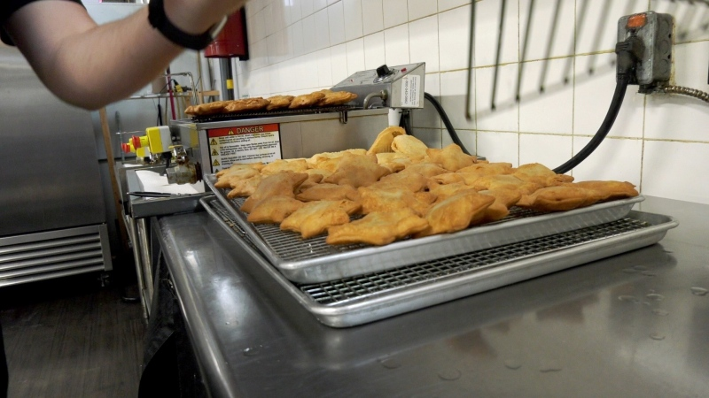 The Fritter Shop produces fritters at The Grove at Western Fair in London, Ont. (Marek Sutherland / CTV News)