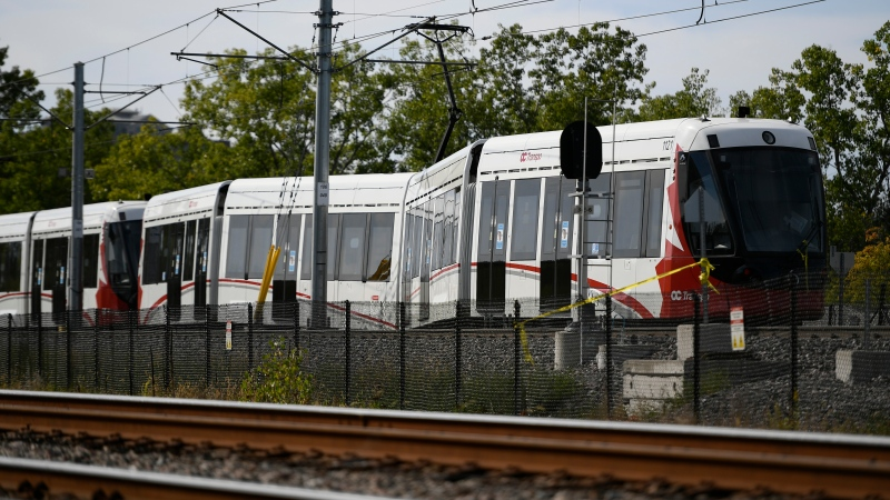 An OC Transpo O-Train is seen west of Tremblay LRT Station In Ottawa on Monday, Sept. 20, 2021 after it derailed on Sunday. (Justin Tang/THE CANADIAN PRESS)