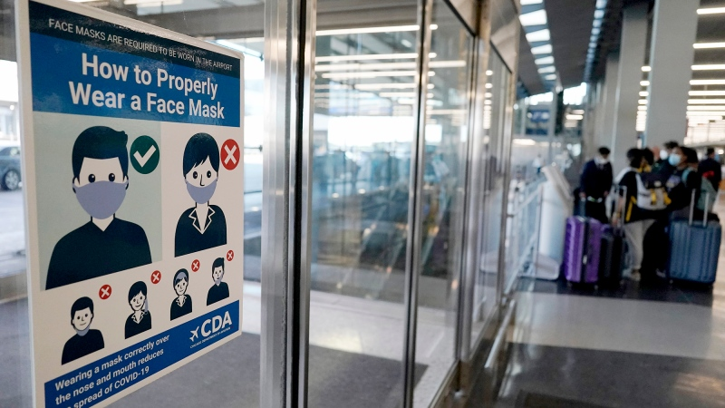 This July 2, 2021 photo shows a sign stating face coverings are required is displayed at O'Hare airport in Chicago, Il. (AP Photo/Nam Y. Huh)