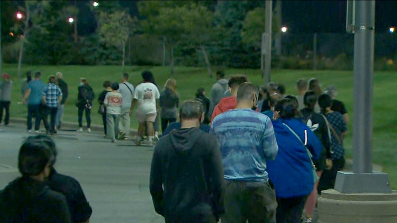 Long lineups of people are seen still waiting to vote at the Trio Sportsplex and Event Centre in Vaughan after the polls closed in Canada's 44th general election Monday September 20, 2021.