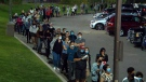 A view of massive lineups outside polling stations in King-Vaughan, Monday, Sept. 20, 2021.