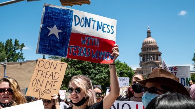 A San Antonio doctor who wrote a Washington Post op-ed claiming that he had violated Texas' six-week abortion ban now faces at least two lawsuits brought against him under the ban, and pictured, protesters on May 29, in Austin, Texas. (Sergio Flores/Getty Images/CNN)