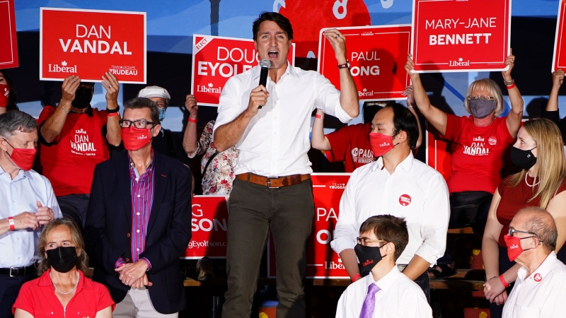 Liberal Leader Justin Trudeau joins fellow Liberal candidates as he makes a campaign stop in Winnipeg, Man., on Sunday, Sept. 19, 2021. THE CANADIAN PRESS/Sean Kilpatrick
