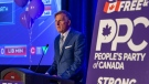 People's Party of Canada Leader Maxime Bernier speaks from a podium to supporters during the PPC headquarters election night event in Saskatoon, Sask., Monday, Sept. 20, 2021. THE CANADIAN PRESS/Liam Richards