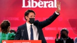 Prime Minister Justin Trudeau greets supporters prior to his victory speech at Party campaign headquarters in Montreal, early Tuesday, Sept. 21, 2021. THE CANADIAN PRESS/Paul Chiasson
