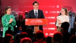 Justin Trudeau is joined on stage by wife Sophie Gregoire Trudeau, left, and children Ella-Grace and Xavier, right, during his victory speech at Party campaign headquarters in Montreal, early Tuesday, Sept. 21, 2021. THE CANADIAN PRESS/Paul Chiasson