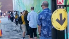 People line up in a school yard to cast their vote at a poling station in Montreal, on Monday, September 20, 2021. THE CANADIAN PRESS/Paul Chiasson
