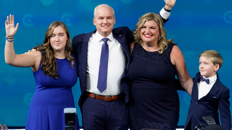 Conservative Leader Erin O'Toole arrives with his wife Rebecca, daughter Mollie and son Jack as he prepares to give his concession speech at his election night headquarters during the Canadian federal election in Oshawa, Ont., on Tuesday, September 21, 2021. THE CANADIAN PRESS/Adrian Wyld
