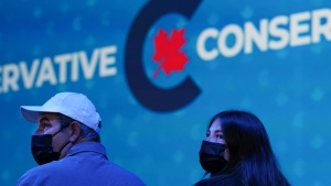 Conservative supporters watch at Conservative leader Erin O'Toole's election headquarters as its been declared a Liberal government win during the Canadian federal election in Oshawa, Ont., on Monday, September 20, 2021. THE CANADIAN PRESS/Nathan Denette
