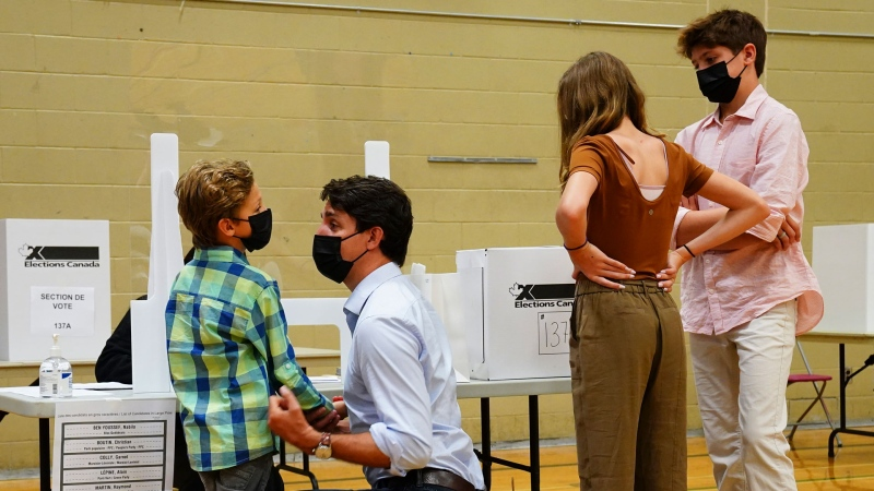 Liberal leader Justin Trudeau votes with the help of his children, left to right, Hadrien, Ella-Grace and Xavier, in his riding of Papineau, Montreal, Quebec on Monday, Sept. 20, 2021. THE CANADIAN PRESS/Sean Kilpatrick