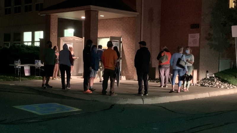 A late night lineup at a Kitchener-Conestoga polling station on Ira Needles Boulevard. (Jeff Pickel/CTV Kitchener) (Sept. 20, 2021)