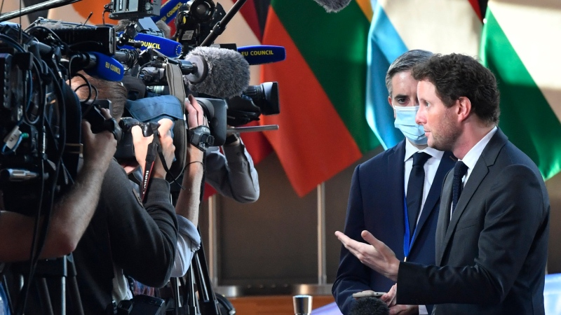 France's European Affairs Minister Clement Beune, right, speaks with the media as he arrives for a meeting of EU General Affairs ministers at the European Council building in Brussels, Tuesday, Sept. 21, 2021.