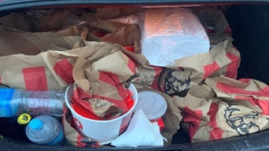 Police say two alleged gang associates were found with a car trunk 'full of KFC' takeout on Sept. 19, 2021. (Source: New Zealand Police via CNN)