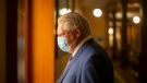 Ontario Premier Doug Ford walks to his office in the Queen's Park Legislature in Toronto on Monday, June 14, 2021. TTHE CANADIAN PRESS/Chris Young