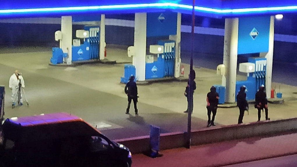 Police at a gas station in Idar-Oberstein, Germany