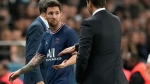 PSG's Lionel Messi looks at PSG's head coach Mauricio Pochettino after he was substituted during the French League One soccer match between Paris Saint-Germain and Lyon at the Parc des Princes in Paris, on Sept. 19, 2021. (Francois Mori / AP)