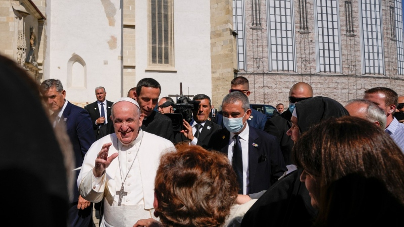 Pope Francis greets faithful as he leaves the Cathedral of Saint Martin, in Bratislava, Slovakia, on Sept. 13, 2021. (Petr David Josek / AP)