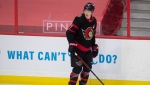 Ottawa Senators left wing Brady Tkachuk skates during warm up before an NHL game against the Vancouver Canucks, in Ottawa, Monday April 26, 2021. (THE CANADIAN PRESS/Adrian Wyld)