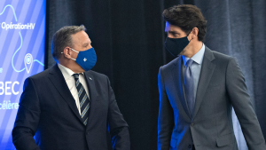 Quebec Premier Francois Legault, left and Prime Minister Justin Trudeau chat after they announced high speed internet for Quebec regions, Monday, March 22, 2021 in Trois-Rivieres Que. The federal government and the Quebec government will collaborate. THE CANADIAN PRESS/Jacques Boissinot