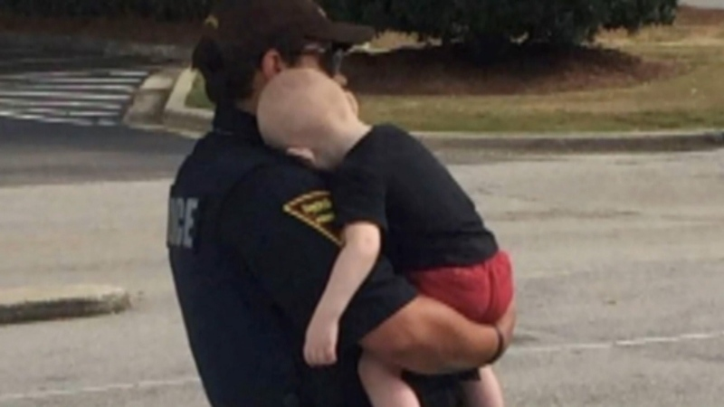 North Carolina police found a one-year-old boy in a car after a passerby noticed his unconscious parents and called 911.