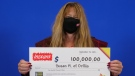 Susan Hill, 57, of Orillia, Ont., holds her big cheque at the OLG Prize Centre in Toronto. (OLG)