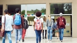 Students entering a school. (Getty Images)