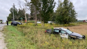 Police investigate a crash involving a police cruiser and civilian vehicle in new Tecumseth, Ont., on Tues., Sept. 21, 2021 (OPP)